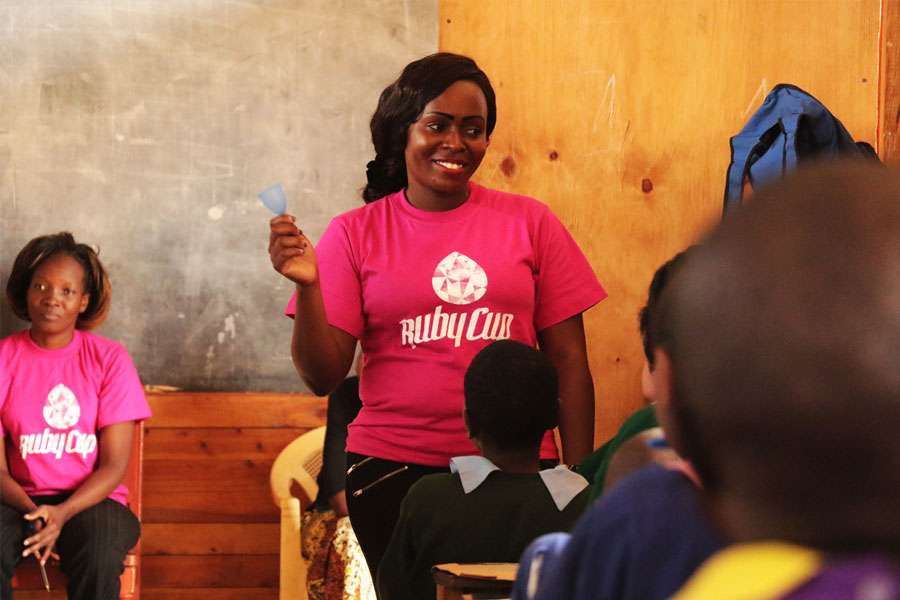 Menstrual Management Trainer Vanessa showing Ruby Cup to the class